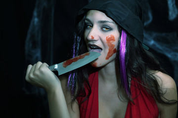 Vampire blood feast, licking knife