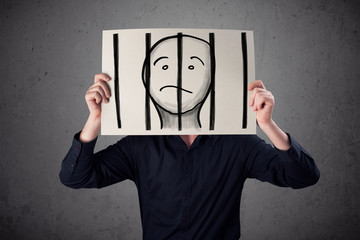 Businessman holding a paper with a prisoner behind the bars on i