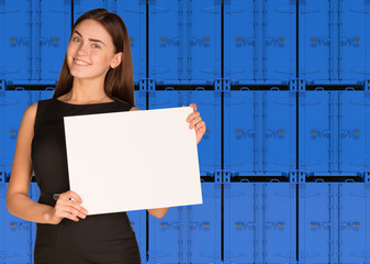 Businesswoman hold paper sheet. Wall of blue containers