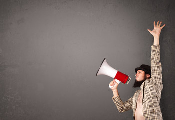 Guy shouting into megaphone on copy space background