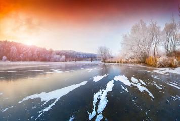 Sunset on the frozen lake.