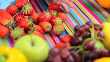 preparing strawberries in colorful kitchen