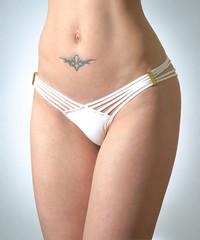 Woman's torso with tattoo in bikini