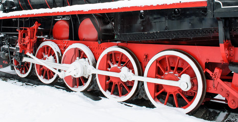 Wheel retro locomotive snow winter, red wheels at the back of