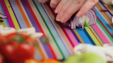 slicing onion in colorful kitchen scene