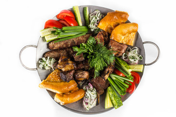 Barbecue set with vegetables, greens and bread