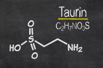 Schiefertafel mit der chemischen Formel von Taurin