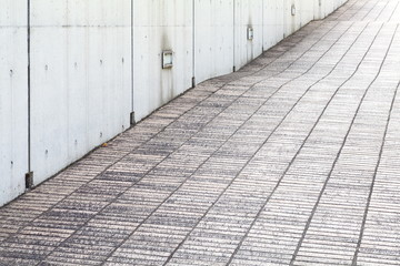 close - up street floor tiles and concrete wall