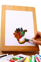 Hand malt auf einer Staffelei