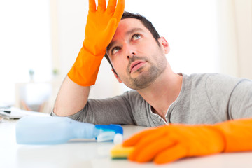 Young attractive man cleaning his flat
