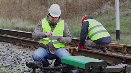 Railway employees working on the railway