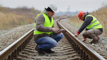 Engineer working with tablet PC on the railway