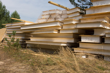 Stacked of Building Materials on Grassy Landscape