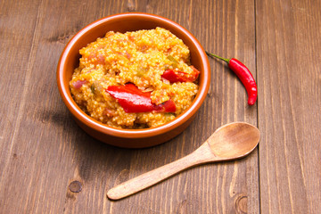Couscous with vegetables on a bowl on wooden table