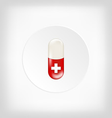 Red capsule pill with medical cross