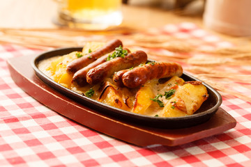 roasted potatoes with sausage in the bar