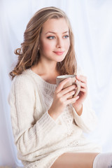 Woman enjoying coffee while relaxing at home
