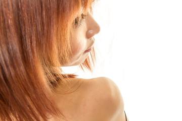 Asian woman looking back over bare shoulders