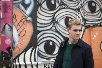 Portrait of blond guy in urban scene