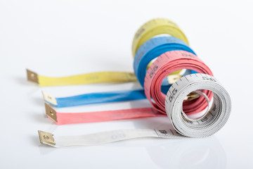 Four colorful  measuring tapes
