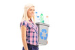 Woman carrying a recycle bin