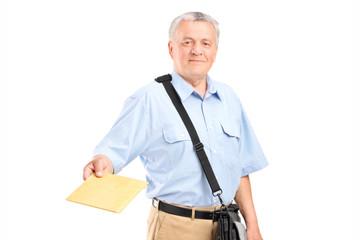 Mailman handing an envelope towards the camera