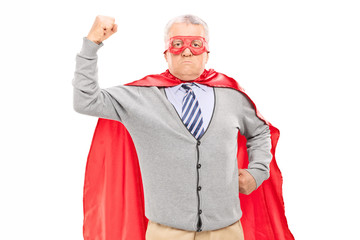 Proud mature man in superhero costume throwing his fist in the a