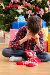 Boy dissatisfied with christmas present