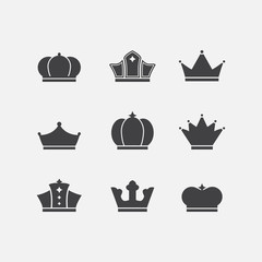 Vector icons set of different  black crowns shapes,signs