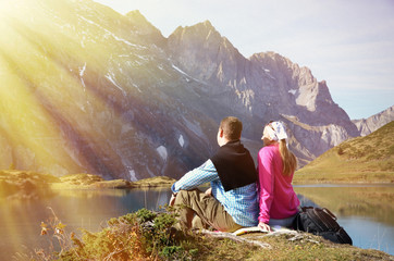 Travelers enjoying alpine view. Switzerland