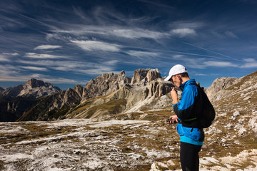 Tourist in Dolomites with GPS