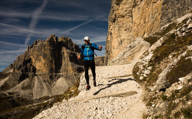 Man running in Dolomites