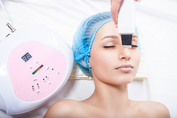 woman getting ultrasound skin cleaning