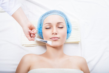 Applying  cosmetic cream by brush