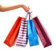 Female hand holding paper shopping bags isolated on white - 72160250