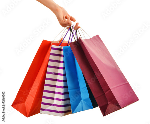 Female hand holding paper shopping bags isolated on white - 72160260