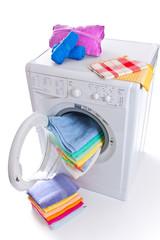 Washing machine with laundry isolated on white