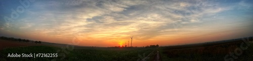 canvas print picture Sonnenuntergang mit Windräder - Panoramafoto