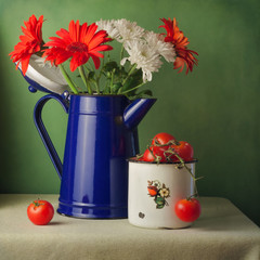 Vintage still life with flowers and cherry tomatoes