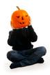 A cute photograph of a boy and her Halloween pumpkin
