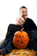 A cute photograph of a two boys and her Halloween pumpkin