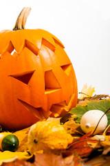 Helloween Pumpkin with autumn leaves