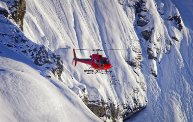 Red helicopter in swiss alps Jungfrau region