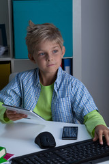 Child using modern technologies