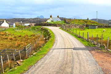 Highlands of Scotland narrow road rural landscape, Uk
