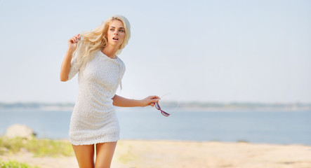 Blond beautiful woman on the beach
