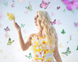 Attractive delicate blonde playing with butterflies