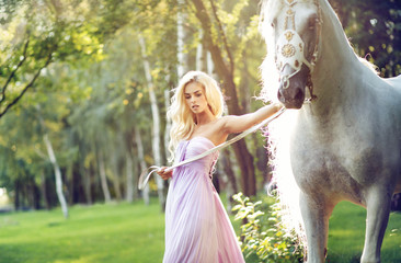 Blond nymph walking with a horse