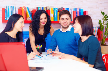 young and creative team discussing business project