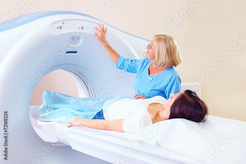 mid adult medical staff preparing patient to tomography - 72168226